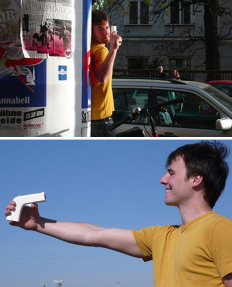 point and shoot gun shaped camera concept
