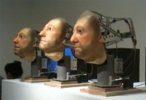 singing robot heads art basel miami 2009