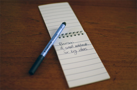 reusable plastic coated paper notebook