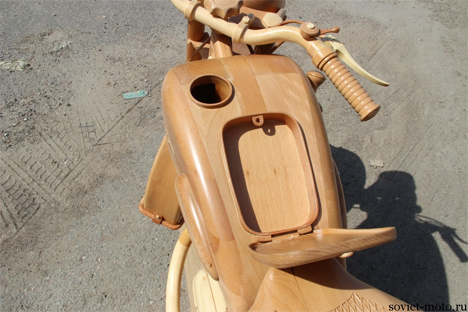 detailed carved wooden motorcycle
