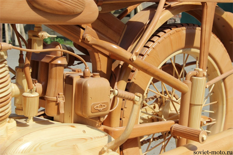 intricate carved wooden motorcycle