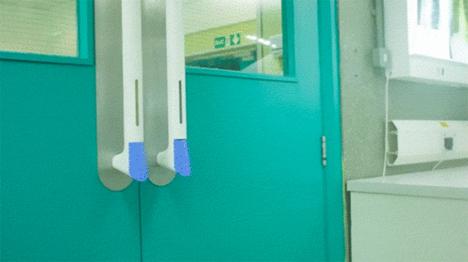 door handle with integrated hand sanitizer