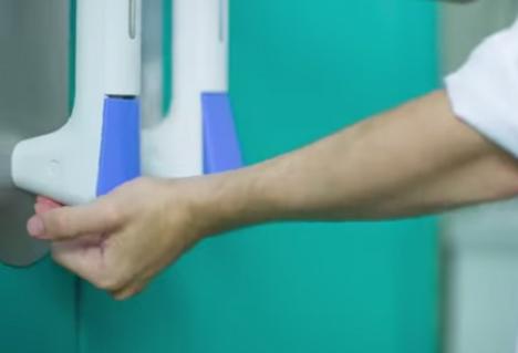 hand sanitizing door handle