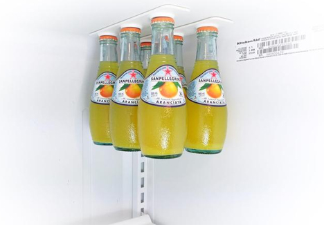magnetic rails hold drinks off fridge shelves