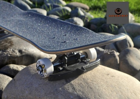 rock deflecting skateboard attachment