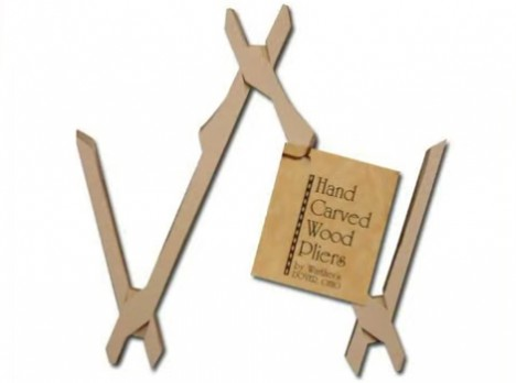 triple hand carved wooden pliers