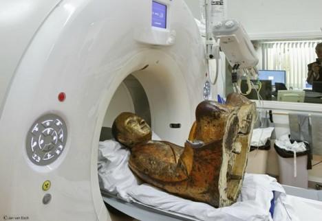 mummified monk inside statue
