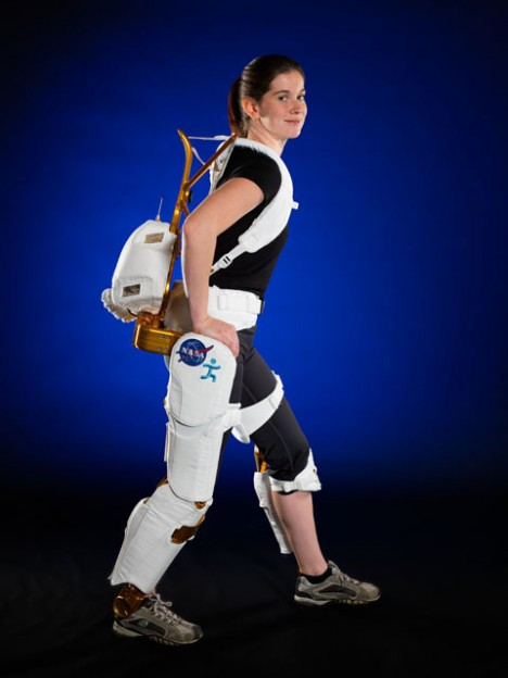 Project Engineer Shelley Rea demonstrates the  X1 Robotic Exoskeleton for resistive exercise, rehabilitation and mobility augmentation in the Advanced Robotics Development Lab in Building 32A Room 1000. Photo Date: 6/1/2012 Location: B32A, Room 1000 Photographer: Robert Markowitz