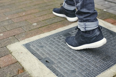 Foot_on_manhole_cover_1