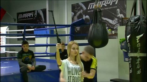 Russians learn self-defense using selfie sticks at a Moscow combat sports center. Deborah Lutterbeck reports.